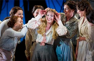 Sarah Tynan as Carrie Pipperidge (centre) with the chorus in Rodgers and Hammerstein's Carousel (Opera North). Photograph: Alastair Muir
