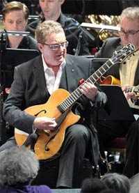 Guitarist Martin Taylor performs with the Britten Sinfonia, Guy Barker Jazz Orchestra and Spirit of Django conducted by Guy Barker at the BBC Proms. Photograph: BBC/Chris Christodoulou