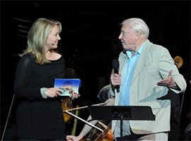 Kirsty Young and David Attenborough with the BBC Concert Orchestra at the Desert Island Discs 70th-Anniversary BBC Prom. Photograph: BBC/Chris Christodoulou