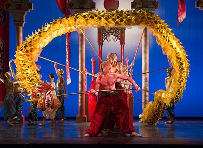Tom Rogers and Artists of Birmingham Royal Ballet in the Dragon Dance; photo: Bill Cooper