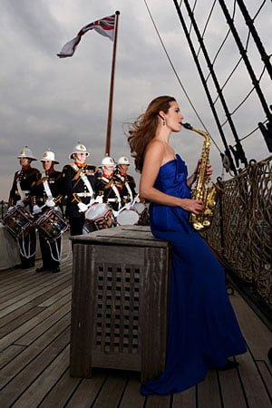 Amy Dickson with band-members from the Royal Marines. photo: LD Communications