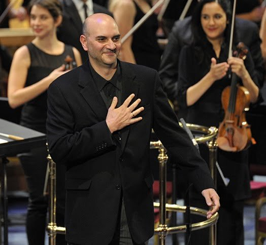 Kareem Roustom takes to the stage after the UK premiere of his Ramal at the BBC Proms 2014. Photograph: Chris Christodoulou