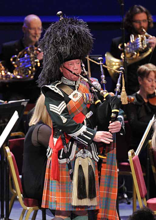 Robert Jordan plays the bagpipes in Sir Peter Maxwell Davies's An Orkney Wedding, with Sunrise with the Scottish Chamber Orchestra conducted by Ben Gernon at the BBC Proms 2014. Photograph: Chris Christodoulou