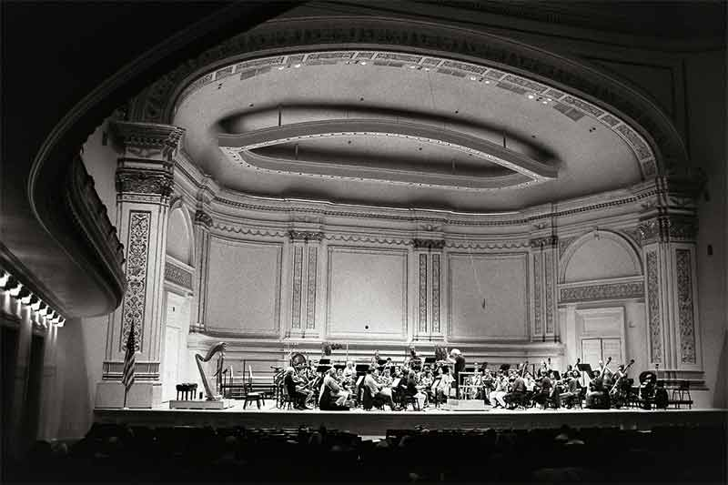 Sir Simon Rattle rehearses the Berliner Philharmoniker in Carnegie Hall. Photograph: Rob Davidson