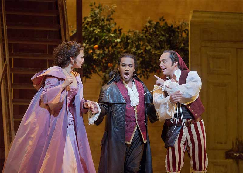 Isabel Leonard as Rosina, Lawrence Brownlee as Count Almamiva, and Christopher Maltman as Figaro, in Rossini's Il barbiere di Siviglia. Photograph: Ken Howard/Metropolitan Opera