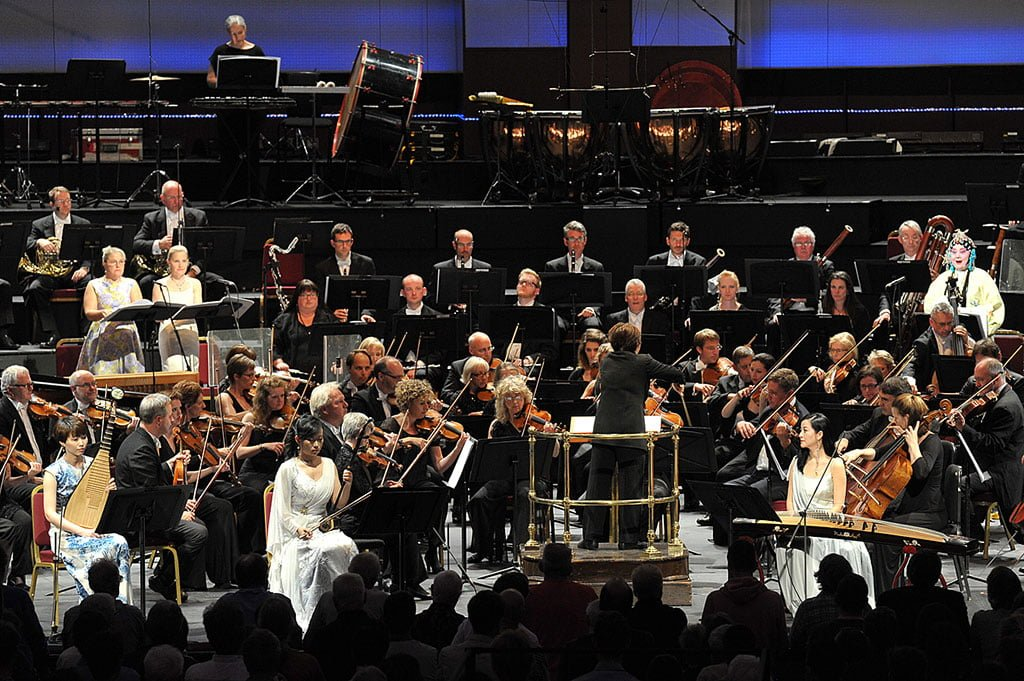 Xian Zhang conducts the London premiere of Qigang Chen's Iris dévoilée at the BBC Proms 2015, with sopranos Meng Meng, Anu Komsi and Piia Komsi; Jia Li on pipa; Jing Chang on zheng; Nan Wang on erhu; and BBC National Orchestra of Wales at the Royal Albert Hall on Wednesday 29 July.Photograph: BBC/Chris Christodoulou