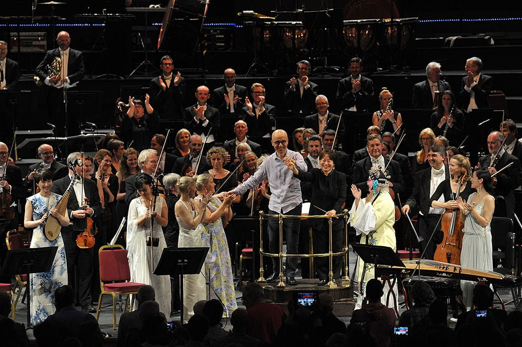 Xian Zhang takes a bow with composer Qigang Chen following the London premiere of his Iris dévoilée at the BBC Proms 2015, with sopranos Meng Meng, Anu Komsi and Piia Komsi; Jia Li on pipa; Jing Chang on zheng; Nan Wang on erhu; and BBC National Orchestra of Wales at the Royal Albert Hall on Wednesday 29 July.Photograph: BBC/Chris Christodoulou