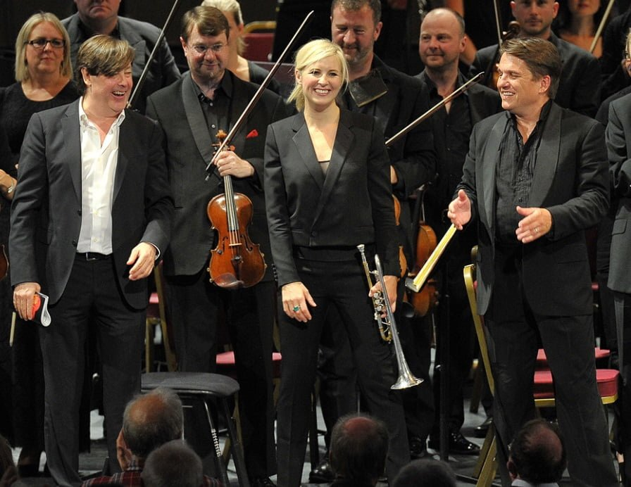 Composer Guy Barker, trumpeter Alison Balsom and conductor Keith Lockhart (L-R) take a bow following the world of Guy Barker's The Lanterne of Light at the BBC Proms on Sunday 6 SeptemberPhotograph: BBC/Chris Christodoulou