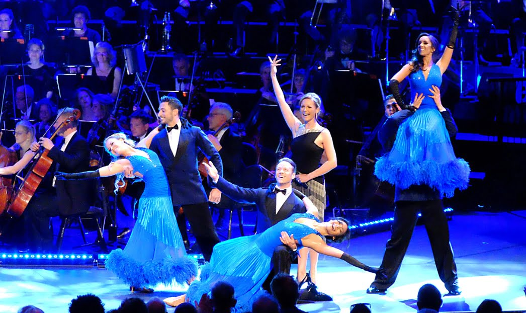 Joanne Clifton, Giovanni Pernice, Kevin Clifton, Karen Clifton, Aljaz Skorjanec and Janette Manrara dance at the Strictly Prom with presenter Katie Derham, conductor Gavin Sutherland and the BBC Concert OrchestraPhotograph: BBC/Mark Allan