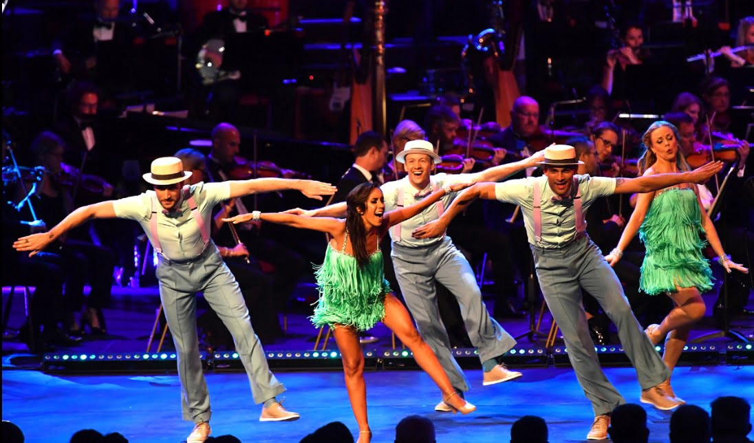 Giovanni Pernice, Janette Manrara, Kevin Clifton, Aljaz Skorjanec and Joanne Clifton dance at the Strictly Prom with conductor Gavin Sutherland and the BBC Concert OrchestraPhotograph: BBC/Mark Allan
