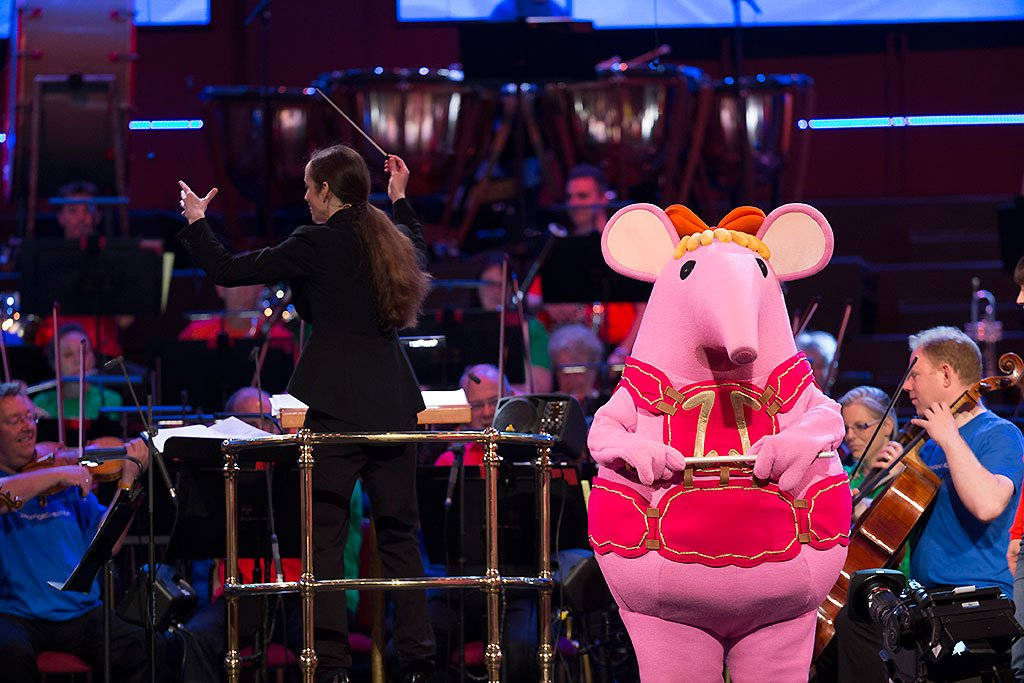 (L-R) Conductor Jessica Cottis and Tiny Clanger with the BBC Concert Orchestra at the BBC Proms 2016.Photograph: BBC/Guy Levy