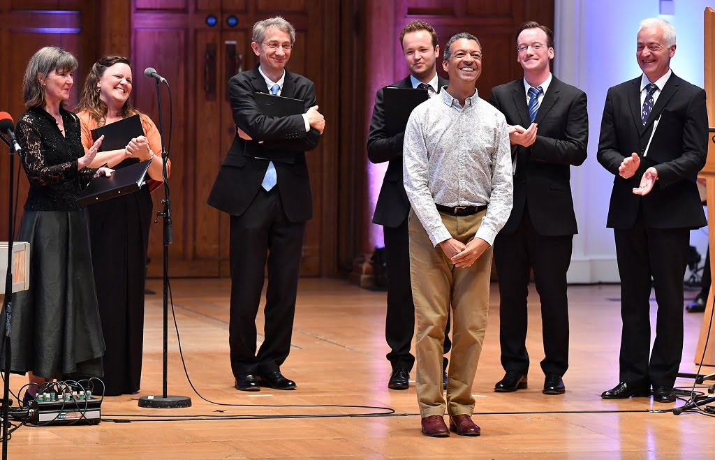 Roderick Williams and I Fagiolini with Director Robert Hollingworth after the world premiere performance of Roderick Williams's Làci darem la mano at the BBC Proms at Cadogan HallPhotograph: Chris Christodoulou/BBC