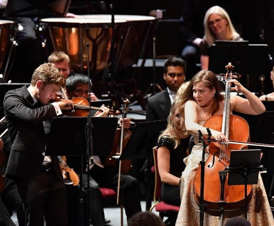 Brother and sister Joshua Weilerstein and Alisa Weilerstein perform Bartók's Transylvanian Dance No. 44 as an encore following their concert together at the Royal Albert HallPhotograph: Chris Christodoulou/BBC