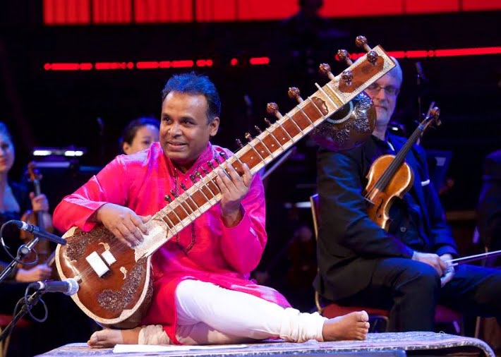 Sitarist Gaurav Mazumdar performs an excerpt of Ravi Shankar's Symphony – Finale: Banjara with the Royal Philharmonic Orchestra under conductor Jessica Cottis at Ten Pieces Presents… Sir Henry's Magnificent Musical Inspirations at the 2017 BBC PromsPhotograph: Pete Dadds/BBC