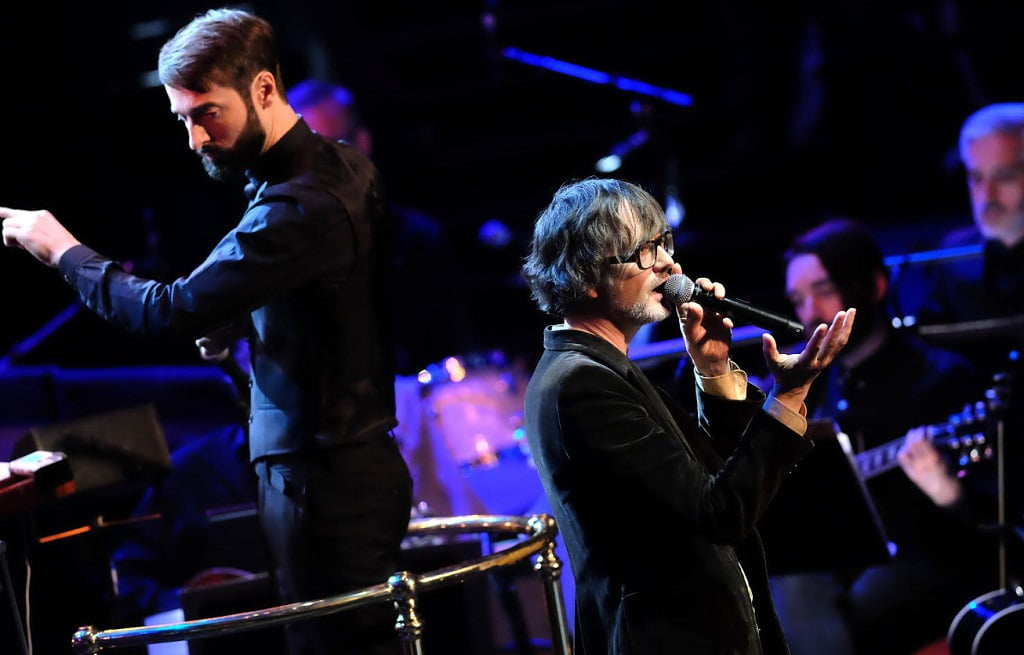 Singer Jarvis Cocker performing at The Songs of Scott Walker (1967-70) with conductor Jules Buckley and the Heritage Orchestra at the 2017 BBC PromsPhotograph: Mark Allan/BBC