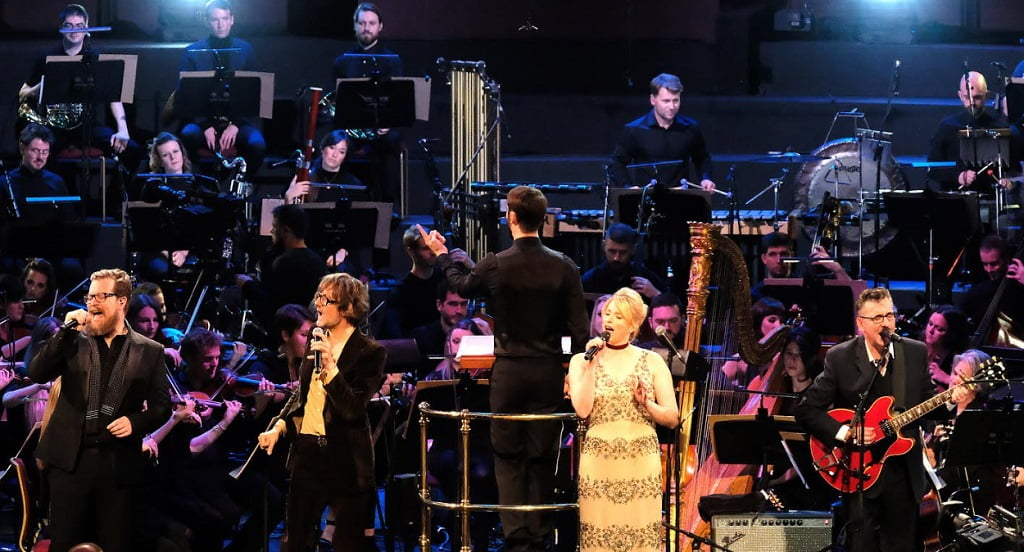 Singers John Grant, Jarvis Cocker, Susanne Sundfør and Richard Hawley perform the finale Get Behind Me at The Songs of Scott Walker (1967-70) with conductor Jules Buckley and the Heritage Orchestra at the 2017 BBC PromsPhotograph: Mark Allan/BBC