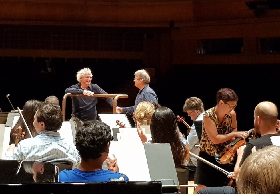 Lennox Mackenzie with Sir Simon Rattle at rehearsalPhotograph: twitter @LondonSymphony