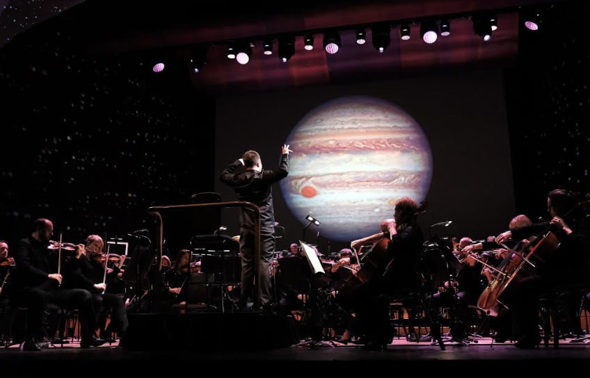 Professor Brian Cox and the BBC Symphony Orchestra present The Planets at the Barbican Hall on Saturday 29th September,  available on TV as part the BBC's Our Classical Century next yearPhotograph: Mark Allan / BBC