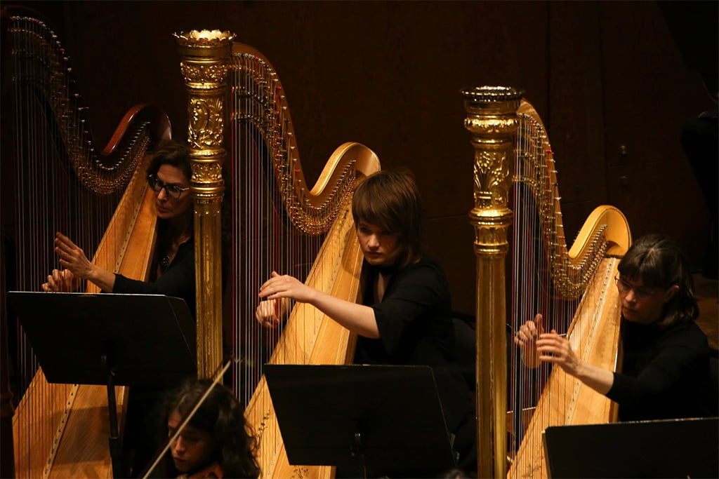 Principal Harp Nancy Allen (right) and two of the four harps that Mahler 6 calls for in totalPhotograph: Caitlin Ochs / New York Philharmonic