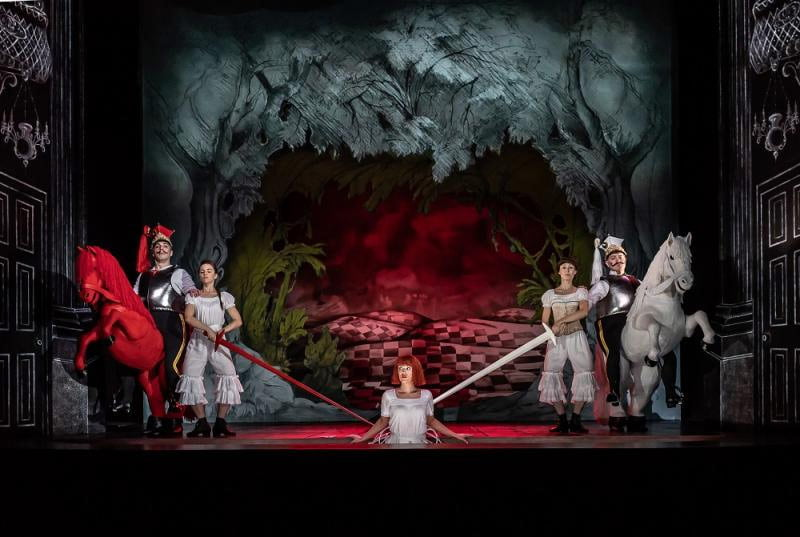 The Royal Opera – Antony McDonald's production of Gerald Barry's Alice's Adventures Under GroundAlice (Claudia Boyle) with the Red Knight (Joshua Bloom) and the White Knight (Mark Stone) and other Liddell sisters (Bianca Hopkins and Eloise Hymas)Photograph: Clive Barda