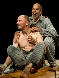 Gerald Tyler as The Condemned Man & Omar Ebrahim as The Officer (In the Penal Colony, Linbury Studio Theatre, 2010). Photograph: Clive Barda