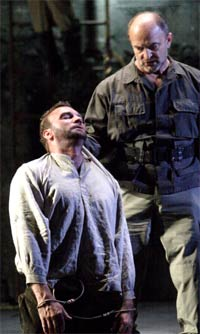 Endrik Wottrich as Florestan, with John Wegner as Don Pizarro (Fidelio, The Royal Opera, March 2011). Photograph: Catherine Ashmore