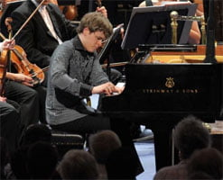 Benjamin Grosvenor becomes the youngest soloist to appear at the First Night of the Proms, performing Liszt's Piano Concerto No.2. Photograph: BBC/Chris Christodoulou